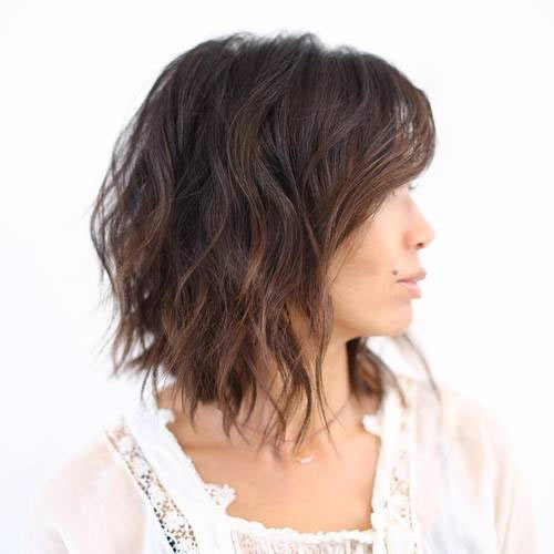 Softly tousled medium bob with subtle blonde highlights for fine hair